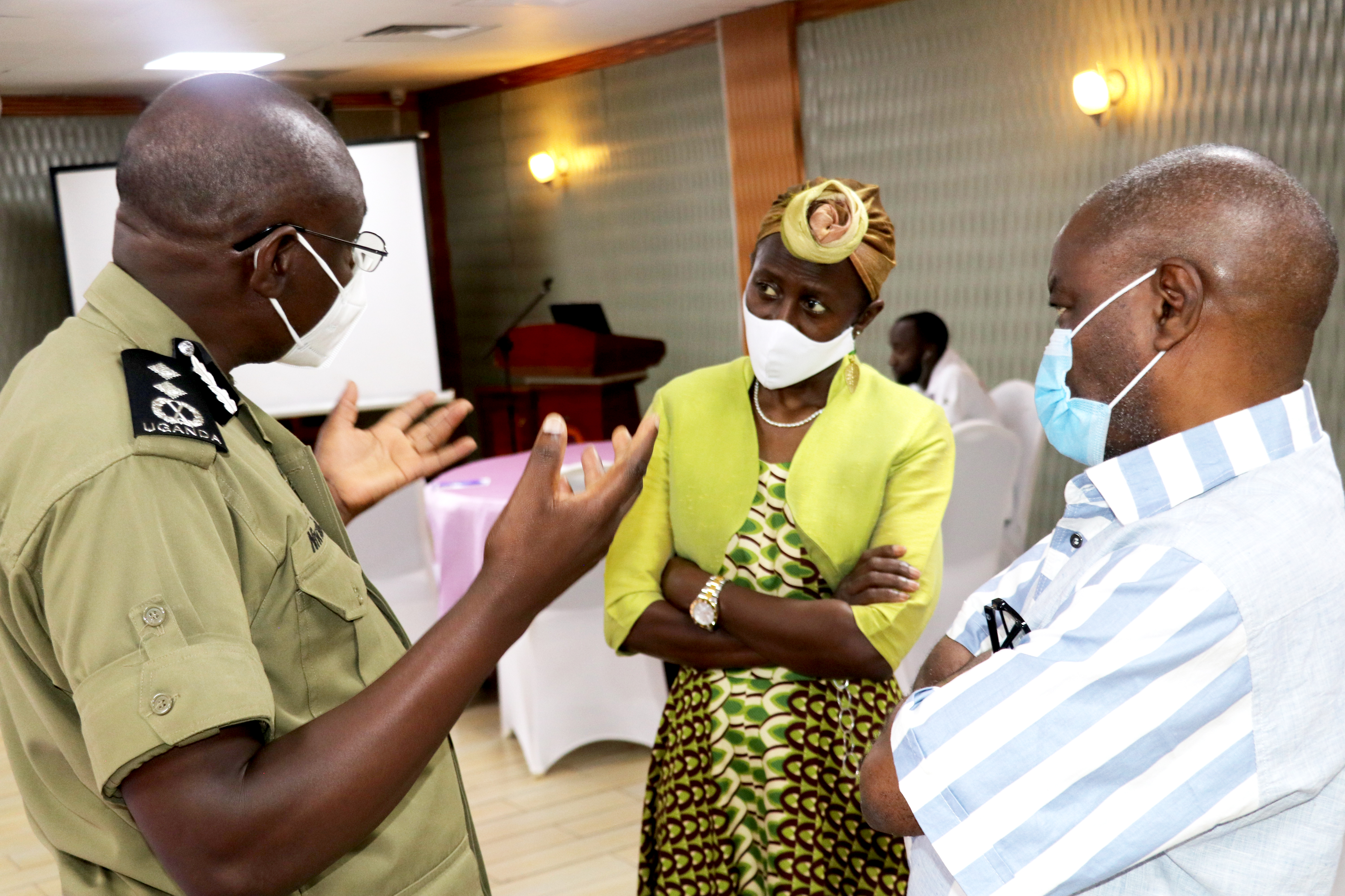 CP Niwabiine Lawrence, the acting Director Traffic and Road Safety in the Uganda Police Force engages Dr. Olive Kobusingye and media trainer Joachim Buwembo, from Uganda Radio Network.